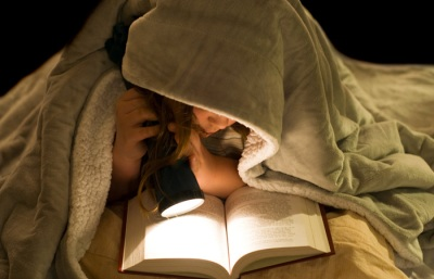 kid reading undercovers